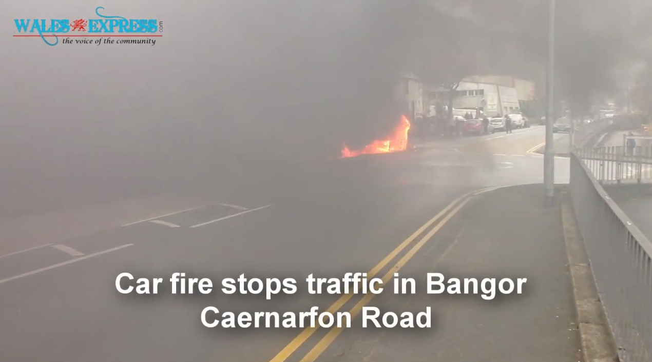 Car fire stops traffic in Bangor