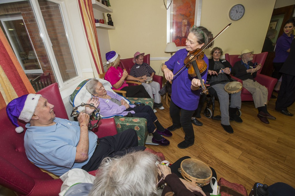 David Petri on keyboard and violinist Carfoline Abbott from the Halle with Pendine Park residents at Cae Bryn. Alan Hassall