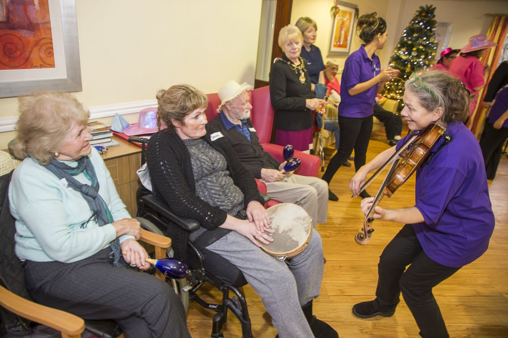 David Petri on keyboard and violinist Carfoline Abbott from the Halle with Pendine Park residents at Cae Bryn care home. Jayne Jones with her mum Lyn Bullen.