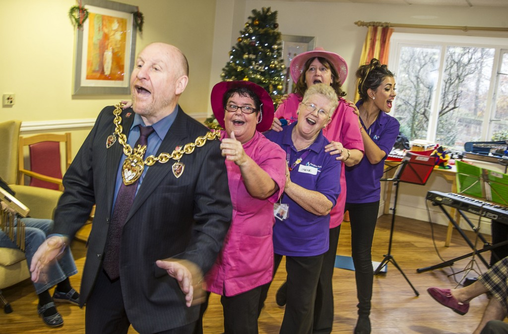 David Petri on keyboard and violinist Carfoline Abbott from the Halle with Pendine Park residents at Cae Bryn care home. The Mayor of Wrexham, Councillor Alan Edwards joined in the fun with staff from left, Lynne Williams, Irene Monks, Yvonne Moran and Olivia Thomas