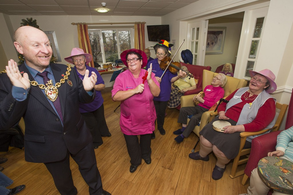 David Petri on keyboard and violinist Carfoline Abbott from the Halle with Pendine Park residents at Cae Bryn care home. Caroline and carer Lynne Williams with resident Christine Jones.