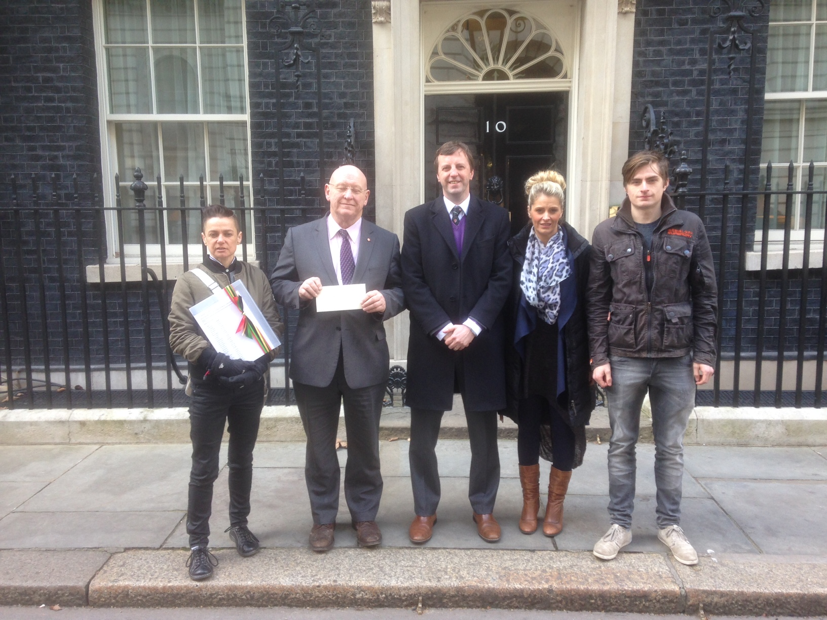 Hywel Williams MP and Jonathan Edwards MP, with Gwenith Owen – Petition Organiser; Nia Price – Mr Williams' constituent; Nathan Price – Mr Williams' constituent. Campaigners go to Downing Street to petition Prime Minister over driving licence