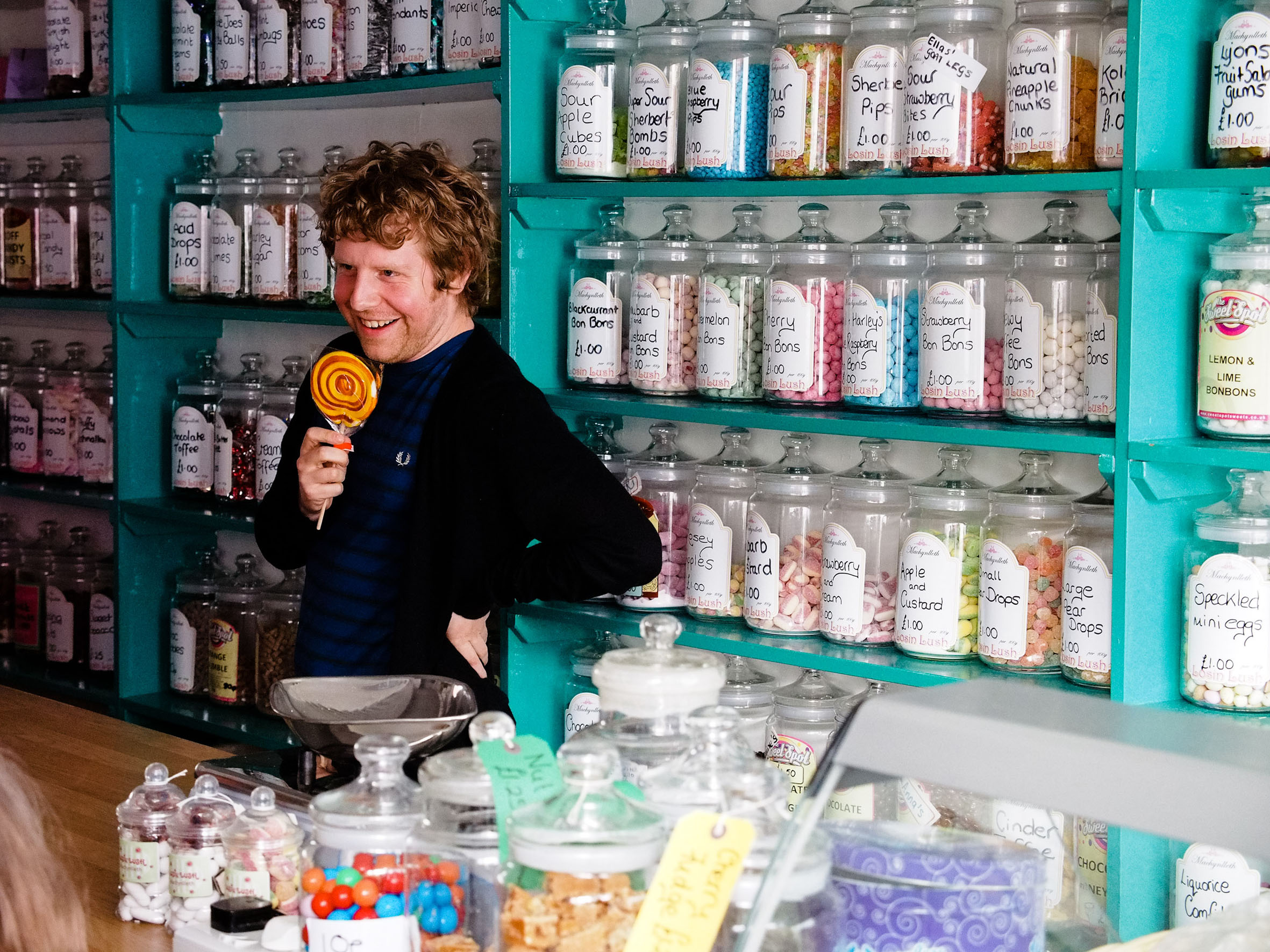 Josh Widdicombe doing a comedy show in a sweet shop in Machynlleth.