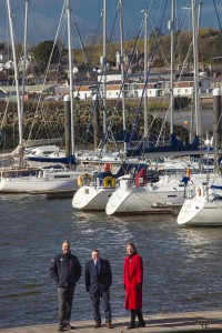 ALL WALES BOAT SHOW PWLLHELI 2015 . Pictured are Steven Morgan of the Welsh Yachting Association, Stephen Tudor Pwllheli Sailing Club and Davina Carey-Evans, Managing Director of Wales Watersports International
