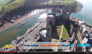Wales Express Aerial Video sponsor space example flying over Caernarfon Castle in North Wales shooting real time Aerial Video