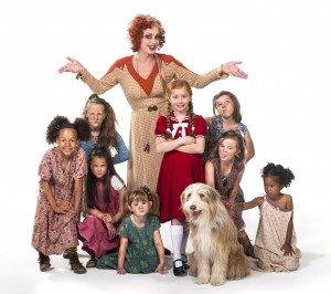 The cast of Annie who appear at Venue Cymru in July. Photo by Hugo Glendinning