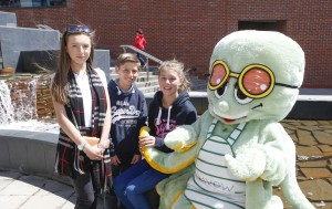 Erddig Rotary Club raise funds for Dynamic with a duck race in the waterfall at Eagles Meadow. Pictured: Mia Williams, Curtis Williams and Ellie Williams support volunteer week meeting the mascot during the duck race.