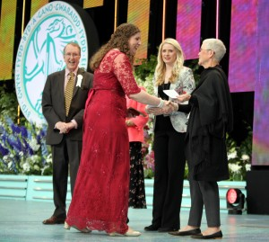 Gillian Blair collects her prize from adjudicators former royal harpist, Claire Jones and right, Maria Helbekkmo of Norway with left, Llangollen International Music Eisteddfod chairman, Gethin Davies.