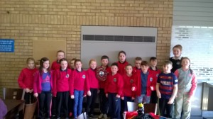 Ysgol Bro Llifon's winning team with swimmer Mari Davies.
