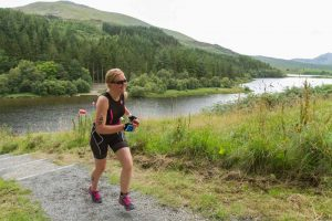 A happy triathlete leaving Plas y Brenin for the run section.