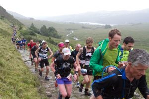 Runners making their way out of Llanberis to start their epic run