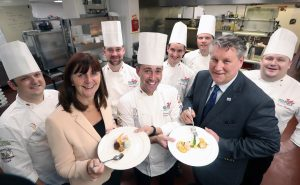 Wales' Cabinet Secretary for Environment and Rural Affairs Lesley Griffiths samples one of the dishes with senior Culinary Team Wales members (from left) Karl Jones-Hughes, Ryan Jones, captain Danny Burke, Michael Ramsden, Simon Crockford, manager Peter Fuchs and Jason Hughes.