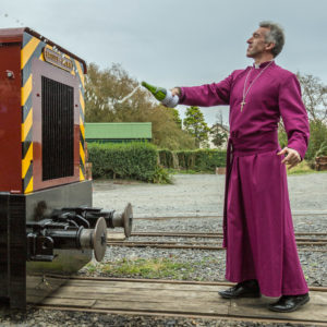 The Bishop of Bangor anoints diesel No.12 St Cadfan with bubbly during the naming ceremony at Tywyn Wharf Station on Sunday. (Photo: Barbara Fuller