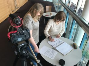 Emmy Williams and Ruth Garnault prepare the crowdfunding script