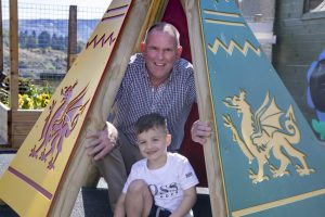 Creative play have transformed the outside play are at Cylch Meithrin Deiniolen; Pictured are Maldwyn Lewis from Creative Play and Theo Peter-Jones.