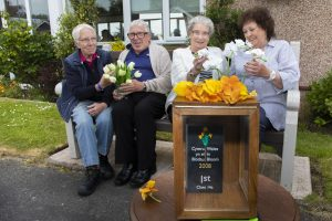 Cartrefi Conwy residents of Park Way , Rhos on Sea who have won Colwyn in Bloom for the last 12 years. and have commissioned the Men's Shed to build a wooden box to hold one their trophies. Pictured are Margaret Richardson, Chair, Richard Blackwell, Vice chair, Eileen Jones, resident and Marion Weatherill, Secretary.