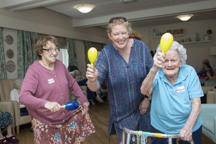 Pendine Park; Hillbury Care Home Residents working with the Welsh National Opera ahead of the International Music Eistedfodd at Llangollen. Pictured (centre) is Jenny Pearon from the Welsh Nationa Opera with residents Shirley Carrington and Margaret Newall.