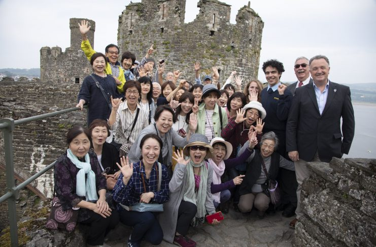 North Wales Tourism Pictured (right ) are Jim Jones, MD of North Wales Tourism Ltd in Llanduddno, ex Mayor of Conwy Cllr Bill Chapman, Leith Jawzi and Lauren Lewsley from CADW with some Japanese tourists.