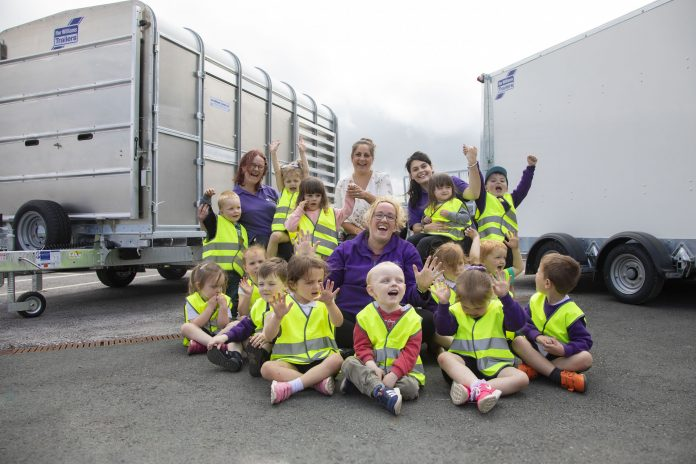 Nursery Children from Cylch Meithrin, Cynwyd at IWT in Cynwyd. Pictured are Nursery Children with Lisa Jones, Sian Roberts and Chloe Jones from Cylch Meithrin, Cynwwyd with (centre) Megan Hatton from IWT.