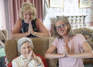St David's Residential Home in Rhyl who have launched a new yoga class for residents ; Pictured is resident Phylis Roberts with Joan Machell, Activities coordinator and yoga coordinator Alison Jones.