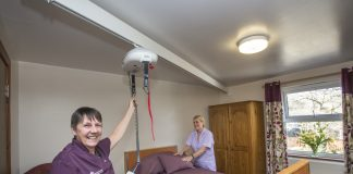 Cariad Care Homes, Porthmadog, investment. Pictured are Jill Jones and Monica Stevenson with one of the new hoists.