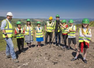 Pictured (L/R) Dan Carrington, Jones Bros, Elis Jones, Siân Fitzgerald, Community Arts Officer, Gwenno Angharad Partnerships Director, Arts & Business Cymru, Rob Spall, Rhys Roberts, Jones Bros site agent, Elisha Henry, Owain Roberts and Lacey Roberts.