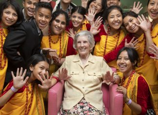 Pendine Park visit from Aroha choir from India; Pictured is resident Nancy Povey with members of the Aroha Choir.