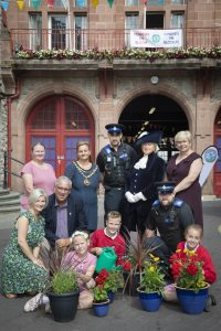 Denbigh in Bloom; Pictured are (Front L/R) Lyndsey Tasker chairman Denbigh in Bloom, Arfon Jones, PCC, pupils from Ysgol Frongoch, Amee Jones, Alfie Corner and Millie Bowman, PCSO David Jones, Helena Cawthray, Denbigh in Bloom; Catherine Jones, Mayor of Denbigh; PCSO Bryn Jones; Lady Charlotte Hanmer, High Sheriff of Clwyd; Sarah Noton, Under-Sheriff;