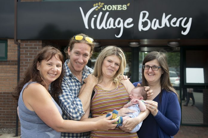 Village Bakery staff meet Baby Tao James Cooke and his parents Matt Cooke and Margaret Edwards; Pictured are Michelle Taylor Jones, Matt Cooke, Margaret Edwards and Jeanette Owens with Baby Tao James Cooke.