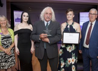 Pictured presenting the Community Champion Award is North Wales Police and Crime Commissioner Arfon Jones with, from left, Deputy Commissioner Ann Griffith, Bobbie Roberts, award winner Kenny Khan and Helen Evans.