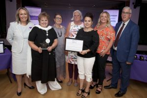 Pictured presenting the Domestic Abuse Support Award to Gorwel is North Wales Police and Crime Commissioner Arfon Jones with, from left, Deputy Commissioner Ann Griffith, Gwyneth Williams, Valmai Squires, Bethan O'Regan, Mair Jones and Rhiannon Thomas.