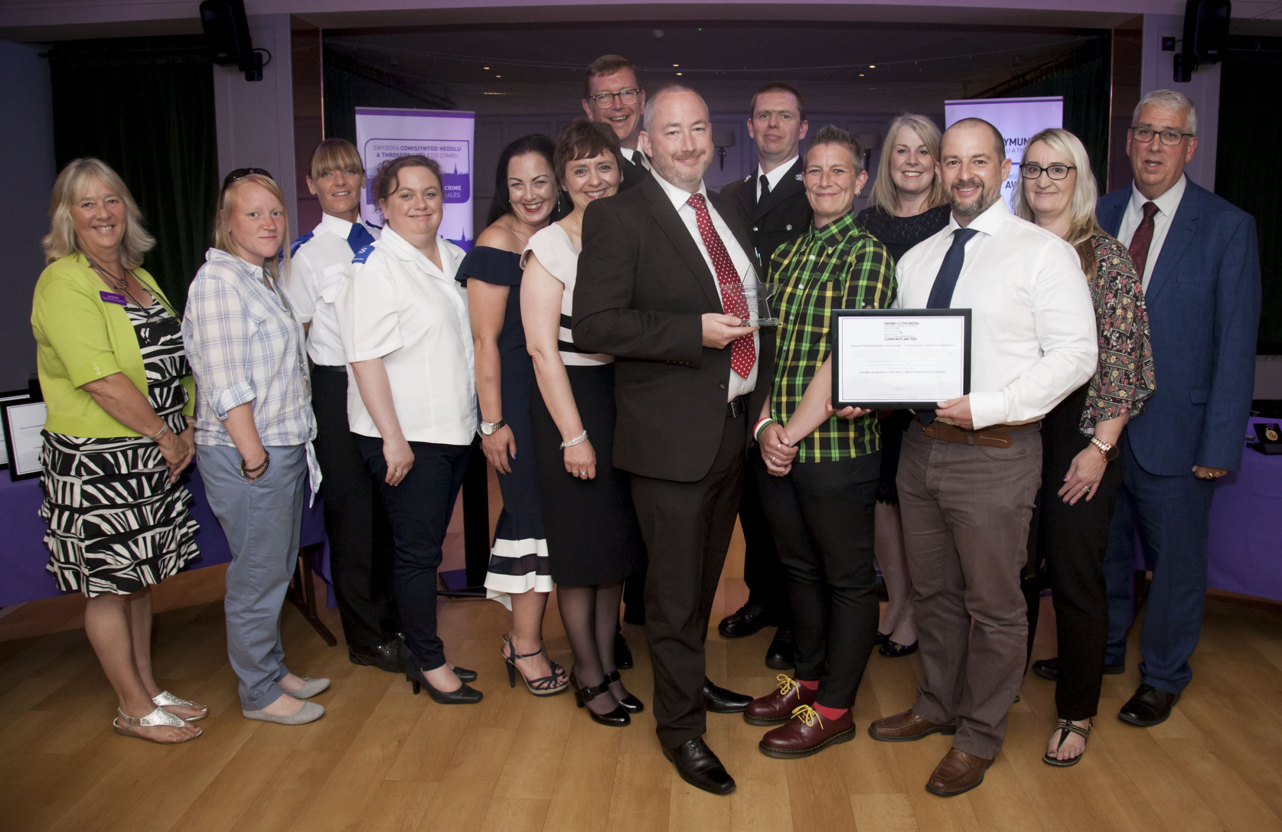 Pictured presenting the Drug Intervention Award to the Wrexham NPS Task Force is North Wales Police and Crime Commissioner Arfon Jones with, from left, Deputy Commissioner Ann Griffith, Katie Harman, NACRO; PCSO Stacey Hughes, Karen Edwards, Salvation Army; Tanya Jones, The Wallich; Rhian Jones, Wrexham County Borough Council; Inspector Paul Wycherley; Steve Campbell, Cais; PC Dave Evans; Wendy Baker and Dr Karen Sankey, Betsi Cadwaladr Community Health Board; Paul Thorpe and Tracey Sutton, both Wrexham County Borough Council.