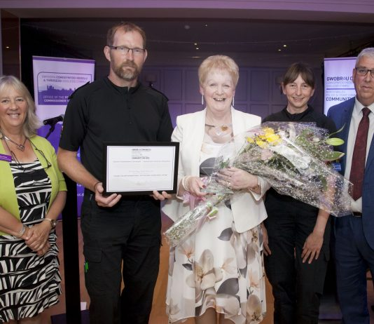 Pictured presenting the Outstanding Achievement Award to Brenda Fogg, of Hope Restored, is North Wales Police and Crime Commissioner Arfon Jones with, from left, Deputy Commissioner Ann Griffith, Sergeant Tom Prytherch and PCSO Pam Hayers.