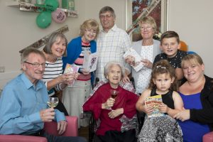 Pendine Park , Hillbury resident Bessie Hughes celebrates her 102nd Birthday with a glass of sweet sherry. Pictured is Bessie Hughes with her nieces and Nephews (from Left) Tony Williams, Wendy Percival, Dianne and Philip Harvey, Myra Campion, Kai Roberts, Evie Roberts and Emma Roberts.