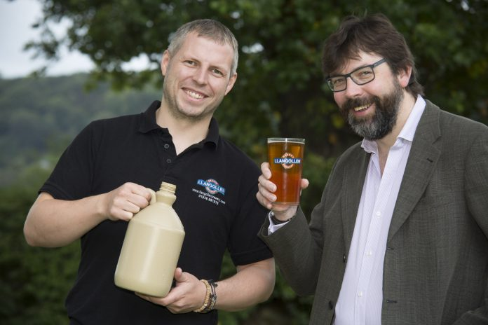 Ynyr Evans a brewer at Llangollen brewery with the special brewed beer to celebrate the 20th anniversary of the llangollen food festival. Pictured are Ynyr Evans from Llangollen Brewery with Llangollen food festival committee member Pip Gale.