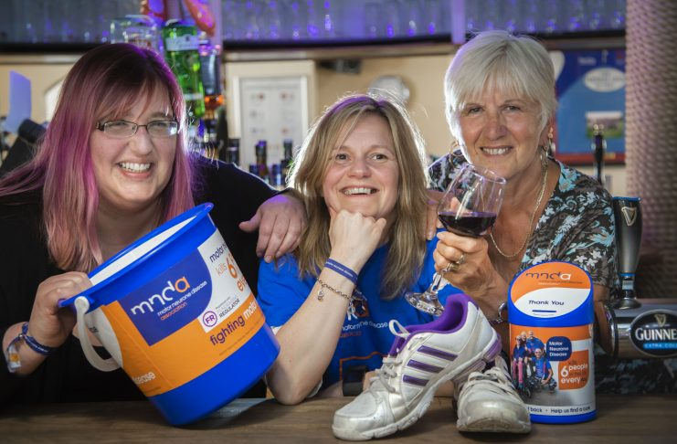 Beth Taylor who is running the Chicago Marathon in aid of motor neurone disease; Pictured is centre Beth Taylor-Lloyd with (from left) Becky Owens and Gill Ryland.