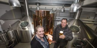 Managing Director Mark Roberts with Donna Hughes, of Wrexham Northern Marches at the Brewery in Wrexham