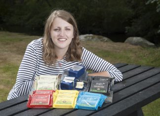 South Caernarfon Creameries have rebranded their cheeses Pictured: South Caernarfon Creameries Sales and Marketing Co-ordinator Meggi Williams with the new Dragon branded cheeses