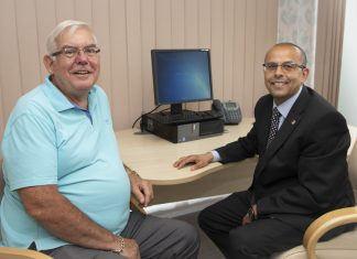Geoff Turner who has had plastic surgery at Spire Yale Hospital in Wrexham to remove a growth on his nose. Pictured is Geoff Turner with surgeon, Professor Fahmy Fahmy who completed the surgery.