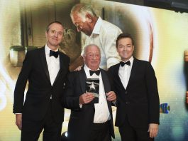 Village Bakery chairman Alan Jones (centre) flanked by Sébastien Guilbert, sales director at award category sponsor Délifrance; Alan Jones; and awards host Stephen Mulhern