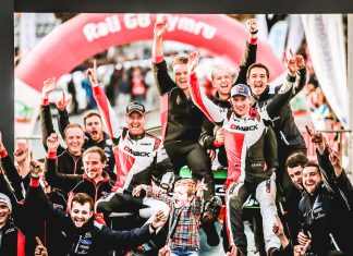Elfyn Evans celebrates last year's Dayinsure Wales Rally GB victory.