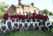 Staff with The Nags Head Inn in the background.