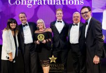 The Trefeddian Hotel's managing director, Caroline Cave-Browne-Cave, her son Tom Cave and general manager William Moeran received the award from a representative of award sponsor Chargemaster watched by host Claudia Winkelman and the AA's hotel and hospitality services managing director Simon Numphud.