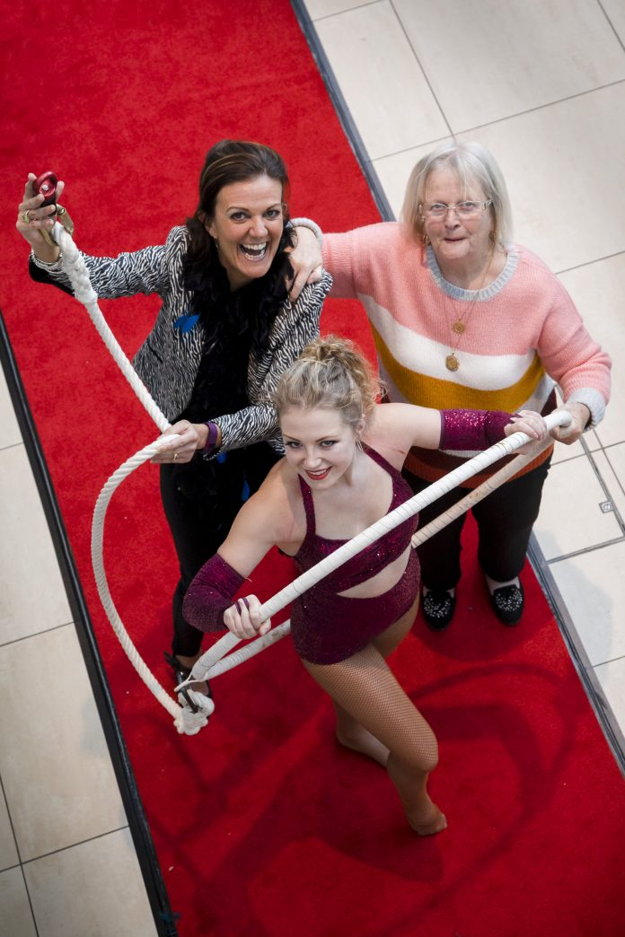 Cartrefi Conwy Older persons day ; Pictured is Acrobat Daisy Williams with Nerys Veldhuizen – Older Person's Engagement Coordinator, Cartrefi Conwy and resident June Parry.