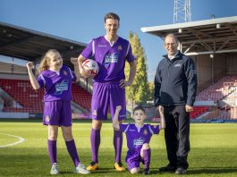 Ifor Williams Trailers WFC New kit launch; Pictured is Wrexham player Jake Lawlor with Russell Williams from Ifor Williams Trailers , Maisie Scragg,10, and Callum Hogan, six.