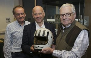 Car enthusiast Dave Jones, Mario Kreft and Lord Dafydd Elis-Thomas with Tom Pryce's helmet