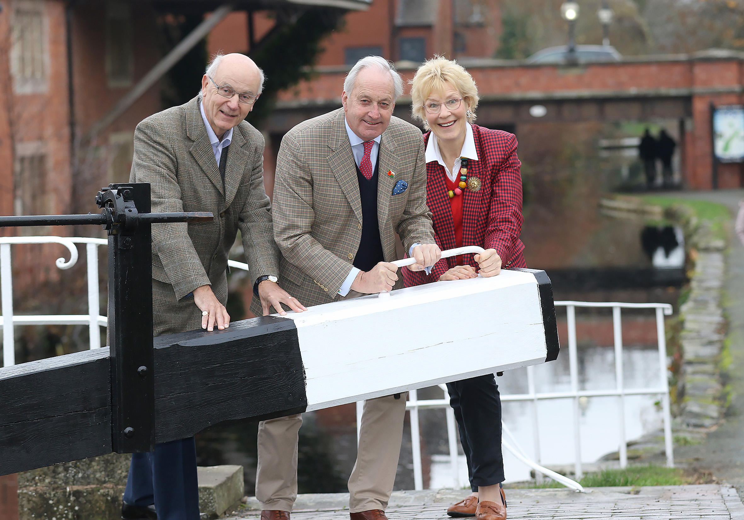 Mid and West Wales AM Neil Hamilton with his wife, Christine and Montgomery Canal Partnership chair John Dodwell