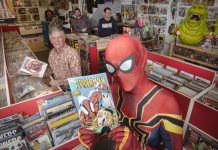 Spiderman drops in at Rhyl Comic and Disc Co to meet, from left, owner and comic expert Stuart Stevenson and staff members Shaun Johnson and Tom Ellis.