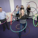 Coxeys staff Hula Hoop with Sasha Kenney from Hoola nation. Pictured are Coxeys staff Anthony Lewis Director, Helen McAllster, Kirsty Roberts, Tracy Perkins and Gruff Hughes with Sasha Kenney.