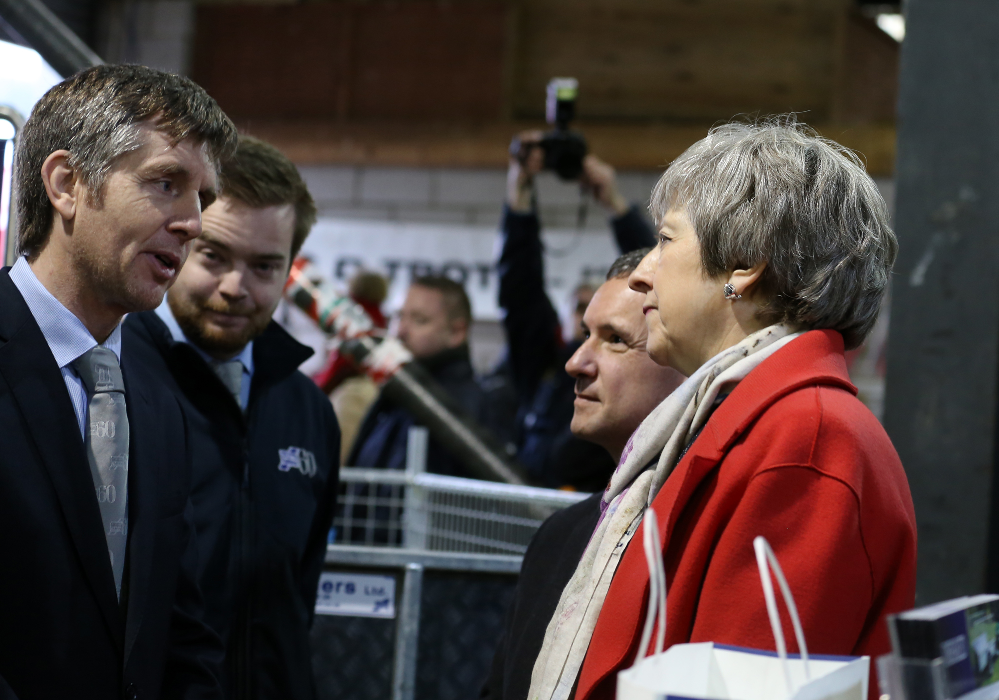 John Williams, the managing director of Ifor Williams Trailers, with Prime Minister Theresa May and Welsh Secretary Alun Cairns.
